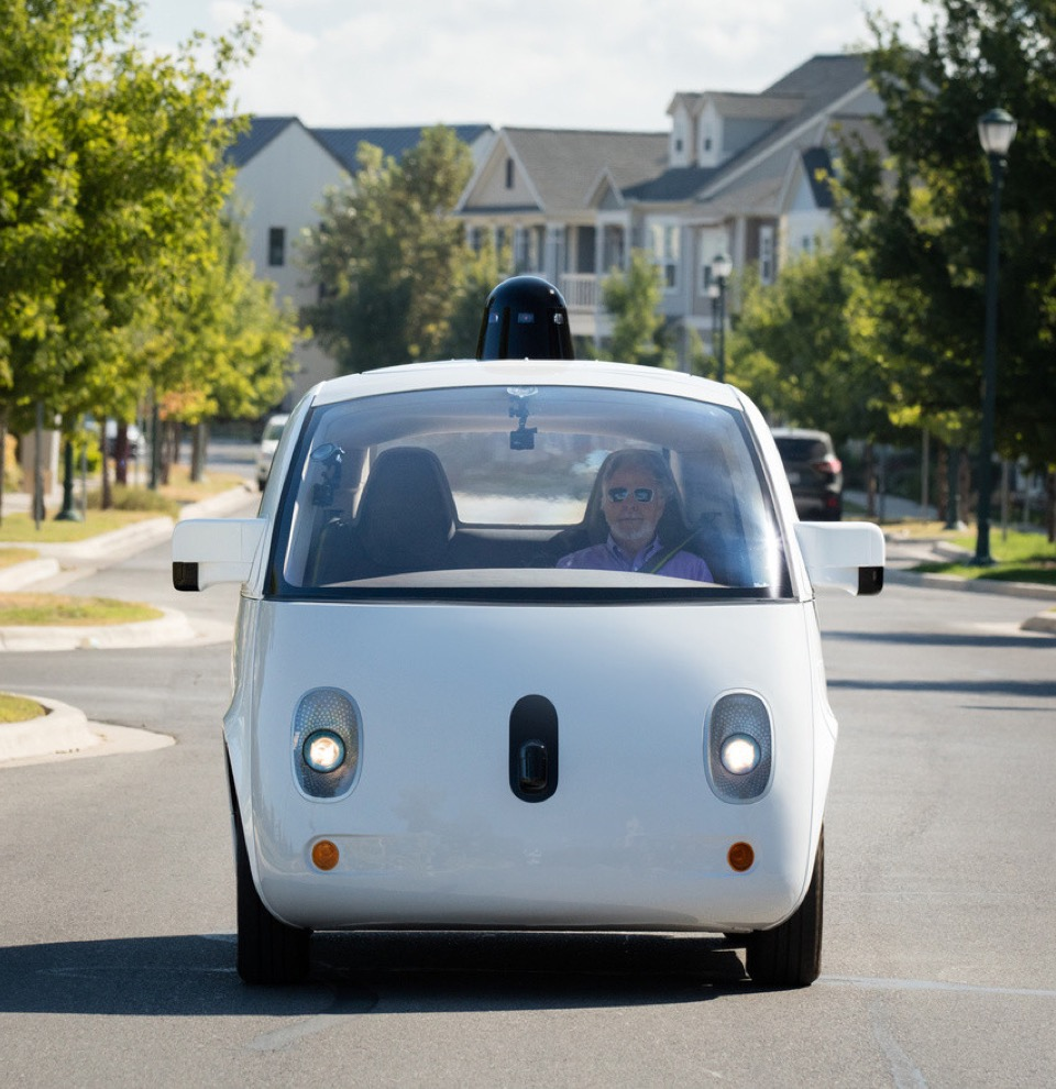 Steve Mahan, who is legally blind, riding in a Firefly Waymo prototype.